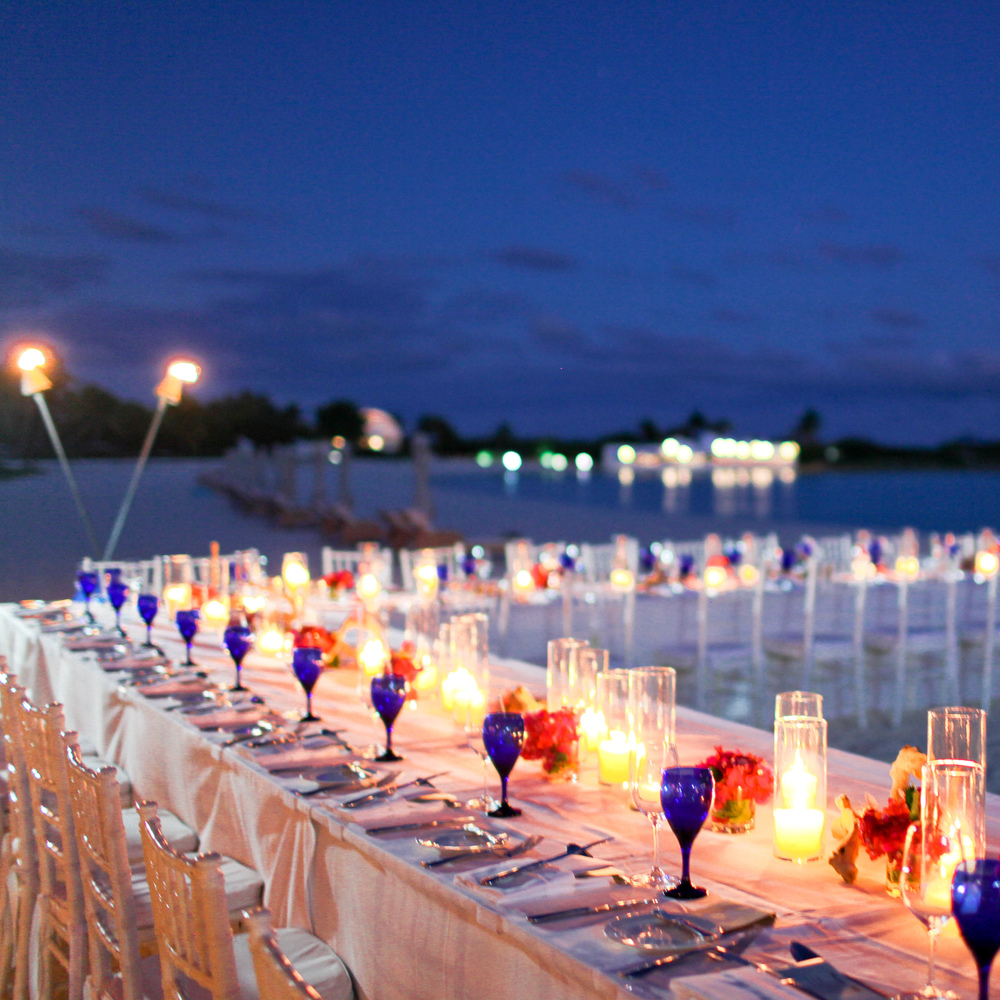 Our wedding dinner on the beach by Cap Juluca on a full moon. Photo by Jen Huang Photography.