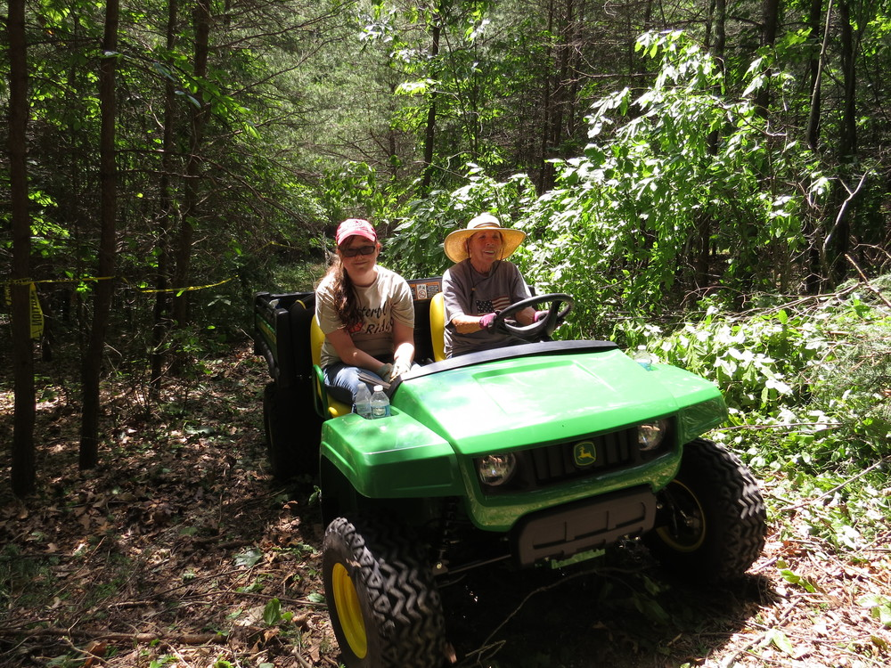 Nancy and April getting their Gator on, hauling freshly cut fence posts and firewood.