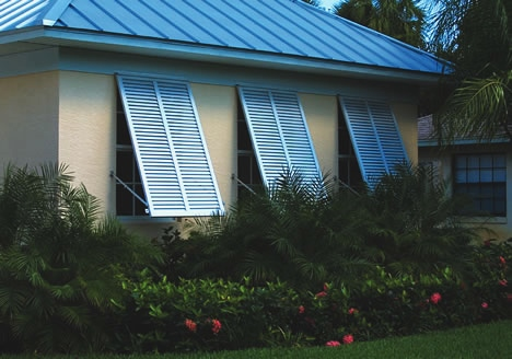 70 Blue Bahama Adjustable Arms Hidden Behind shutters
