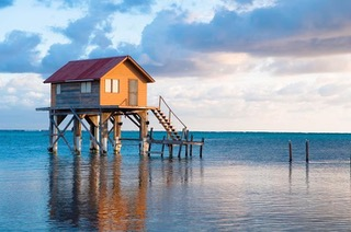 AMBERGRIS CAYE WATER AND HOUSE.jpeg