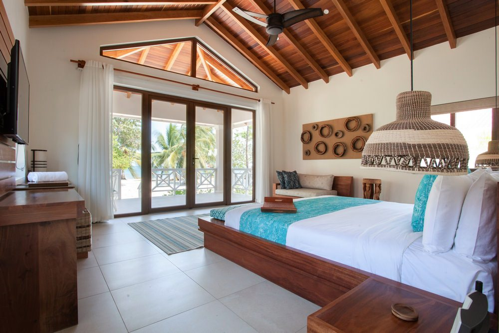 beach front studio suites  feature direct views of the sea. with just 10 steps to have your feet in the ocean. wake up to the sound of the ocean and roll out of bed right into a beachfront hammock. these studio suites are designed with local belizean hard woods, 1 King Bed, outdoor garden rain shower and luxury amenities.