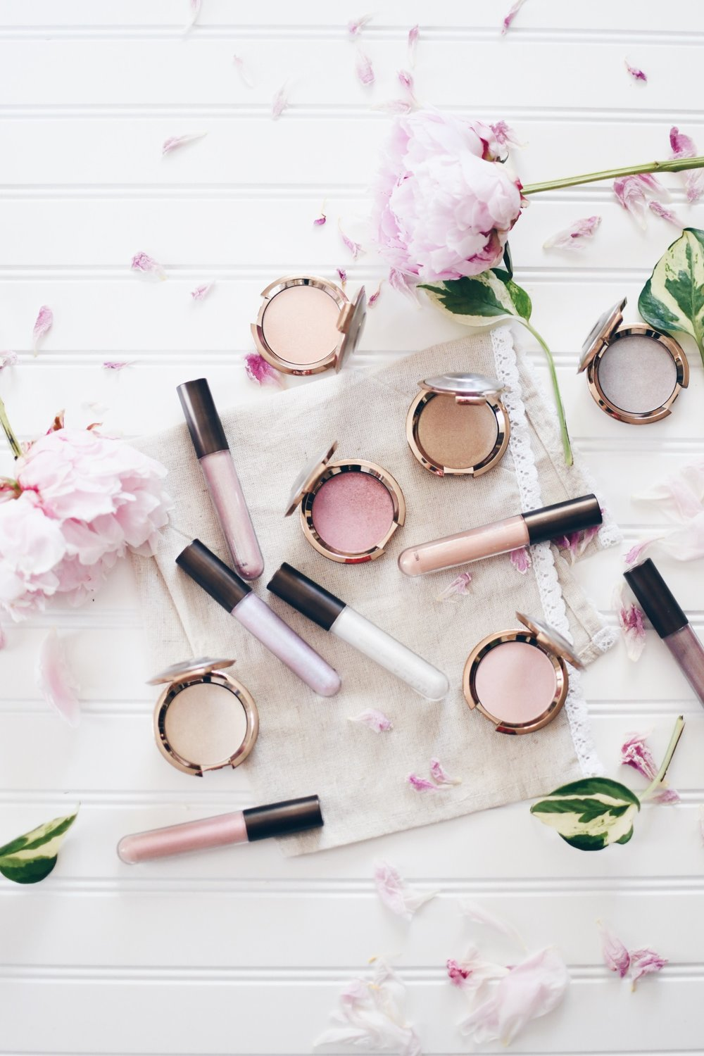 becca cosmetics highlighters and lip glosses