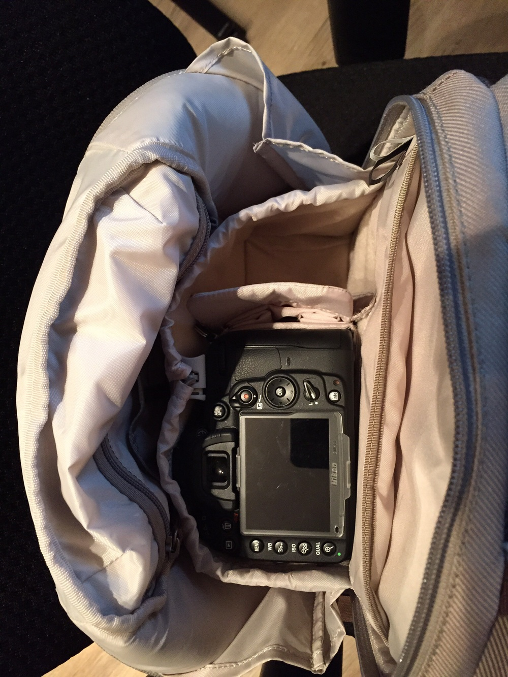 Here's the Nikon D7000 with a Nikkor 35mm attached, face down in the top compartment.