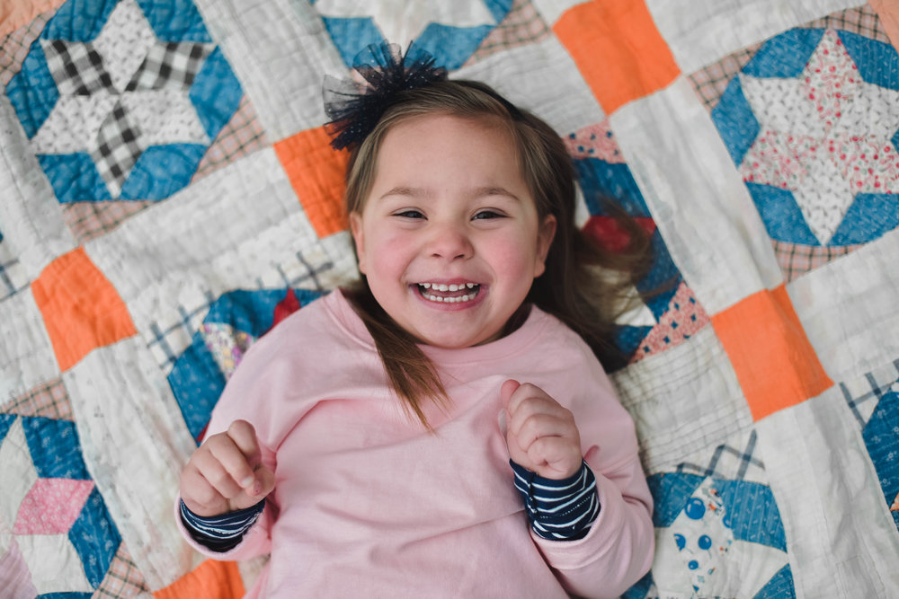 Seriously... this girl was such a trooper. Were talking it was COLD this past Sunday and she acted like it was 70 degrees and sunny! I was so happy to try out my new quilt from Stitched & Found for Maddie's session! I just ordered 2 more for this Spring, I can't wait to show you all.