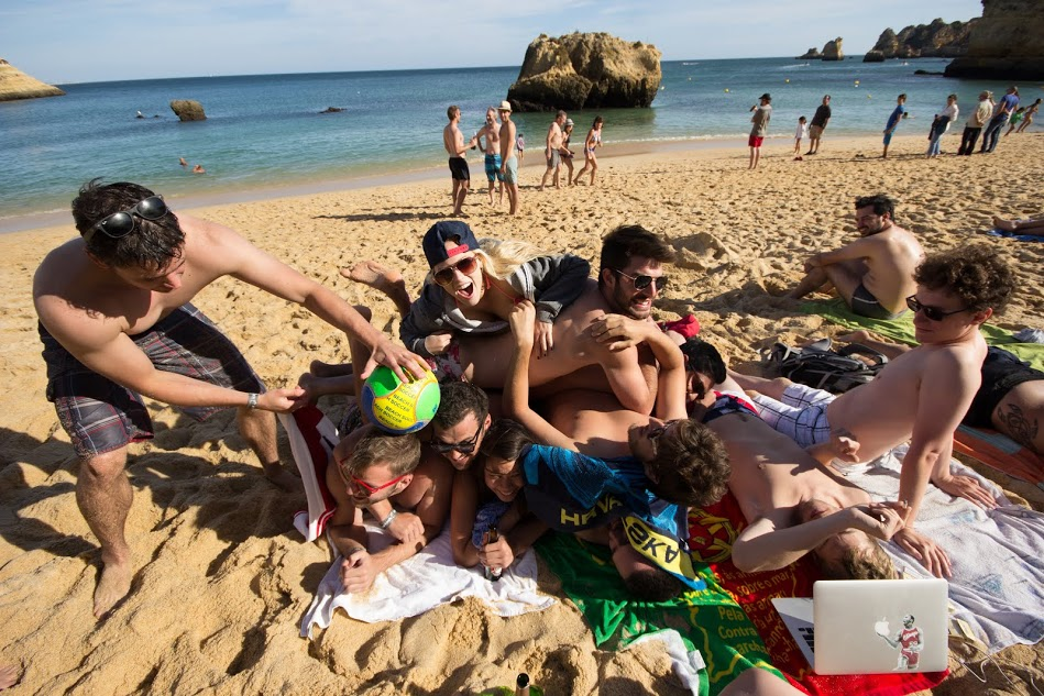 A few members of the sales team (and others) clowning around on the beach in Portugal. Work hard play hard?