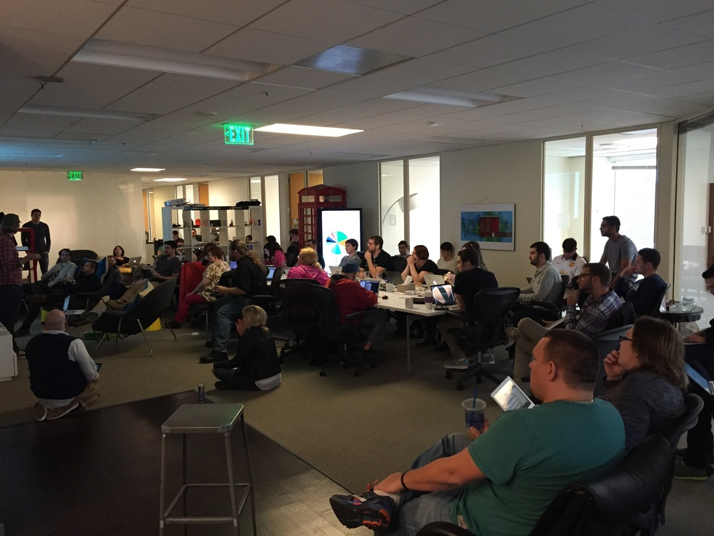 The Expensify Crew at one of our monthly all hands meetings.