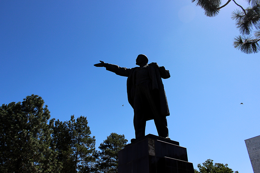 A statue of Lenin stands behind the National Library in Bishkek, Kyrgyzstan