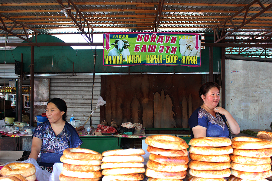 Women selling some kind of delicious naan-like bread product at Dordoy Bazaar in Bishkek, Kyrgyzstan.