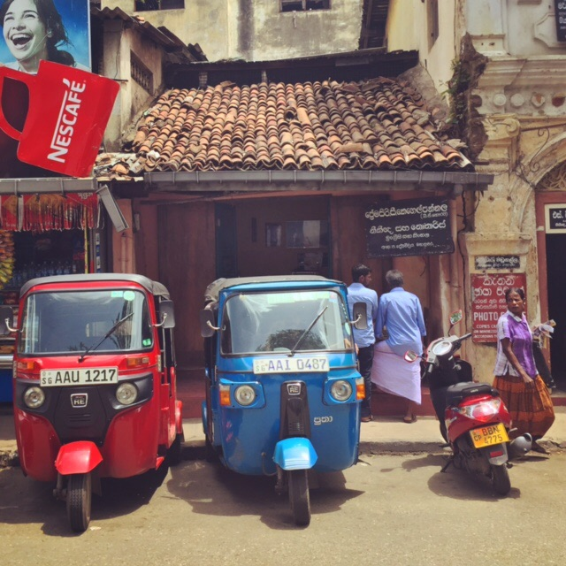 "Classic Sri Lankan ""three wheelers"" parked on a street in Kandy."