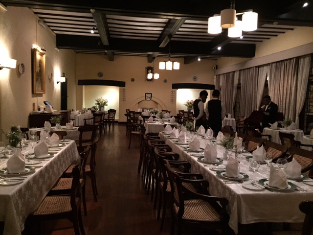 The tables set for dinner in the Hill Club's dining room. (Picture taken before the lights were dimmed and the candles lit.)