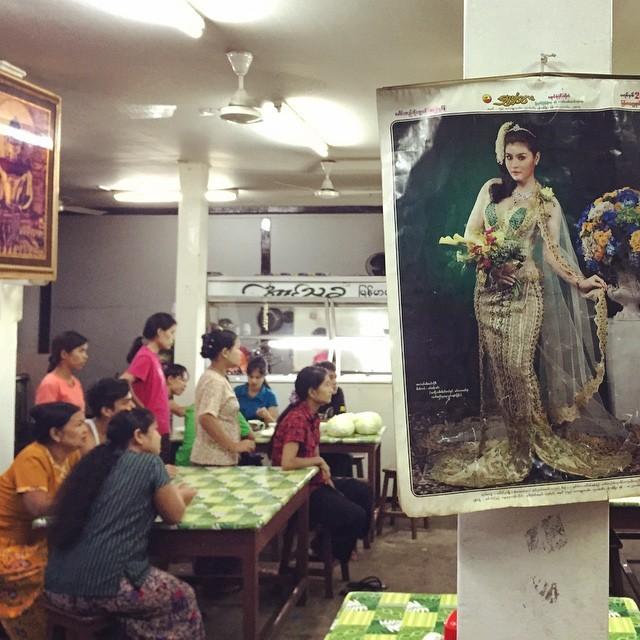 Women watch a soccer game in a restaurant in Yangon, Myanmar