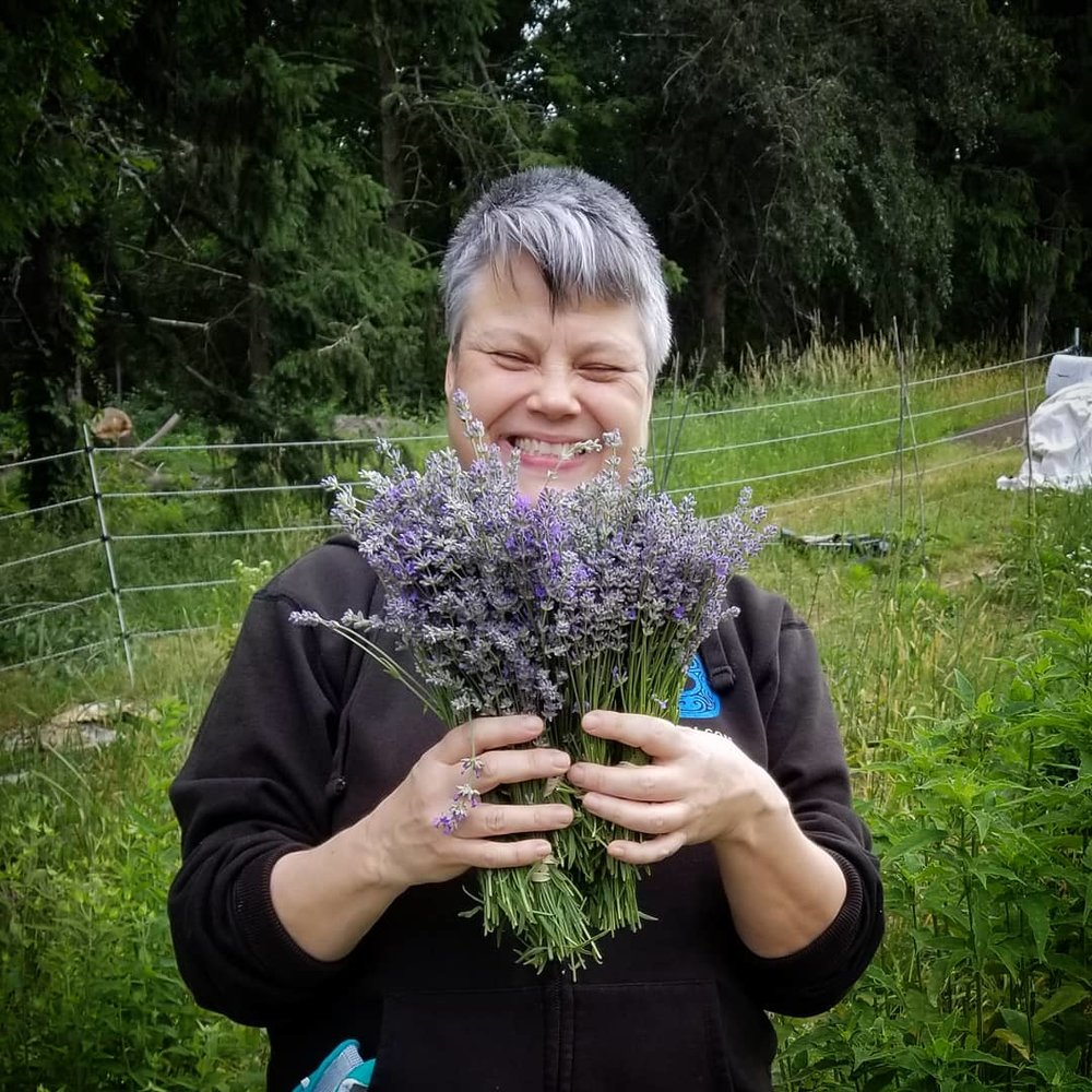 CSA member Marianne with a Lavender bouquet.