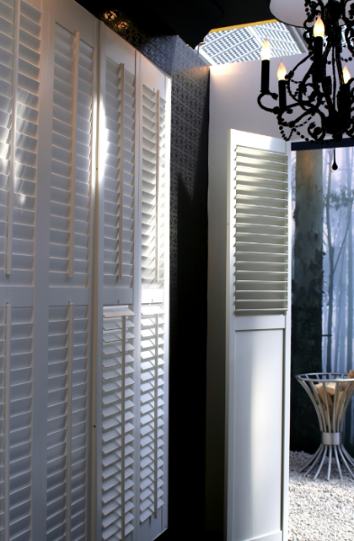 Full height shutters separate areas of the house and are used as room dividers