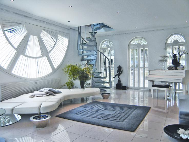 Stunning design interior with white plantation shutters