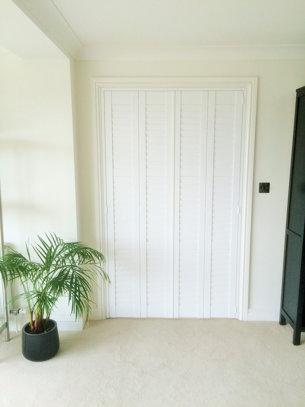 Shutters dividing a room