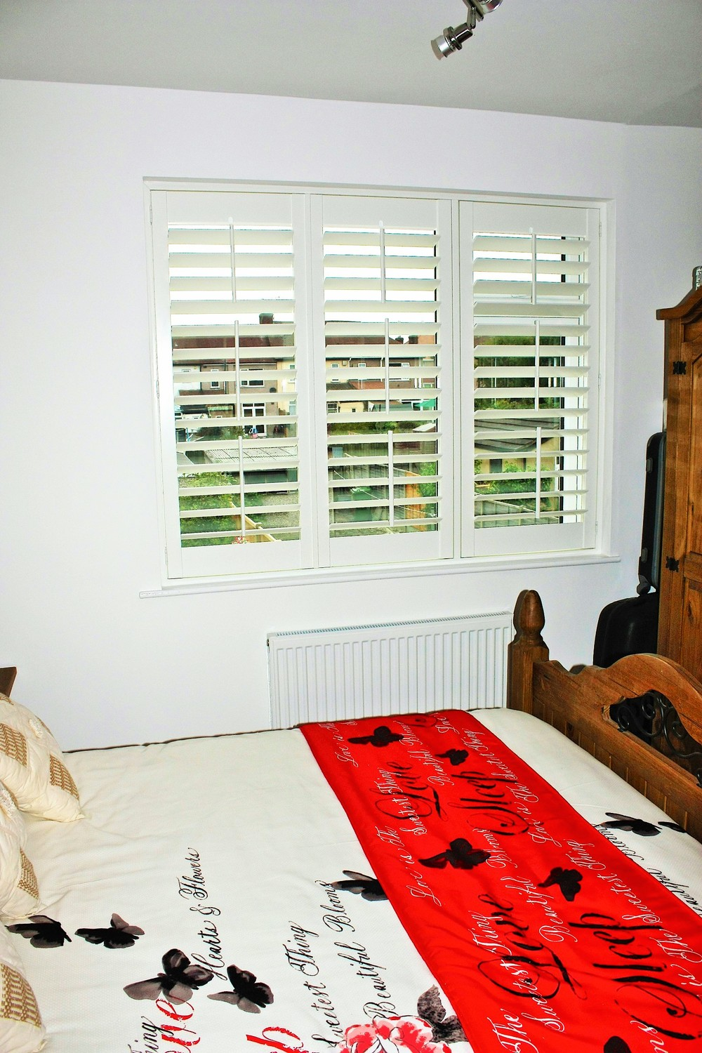 american-style-shutters-for-privacy-in-bedroom.jpg