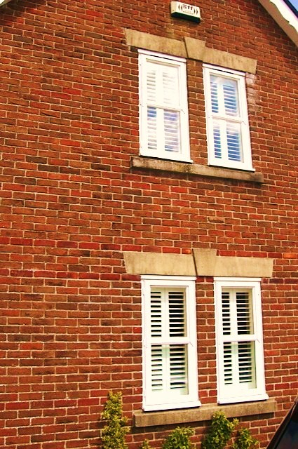 house-with-shutters-view-from-windows-outside.jpg