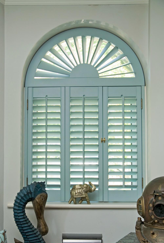 Blue wooden interior plantation shutters