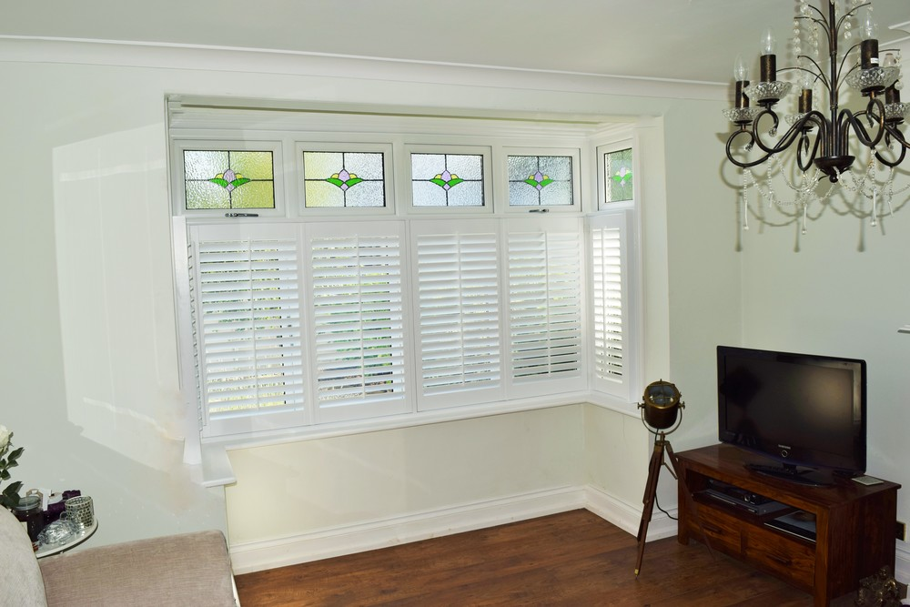 Wooden plantation shutters bay window