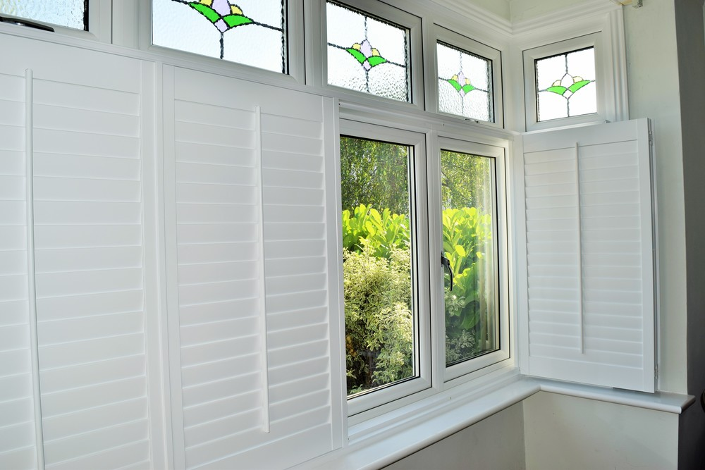 Bay window shutters open Christchurch Dorset