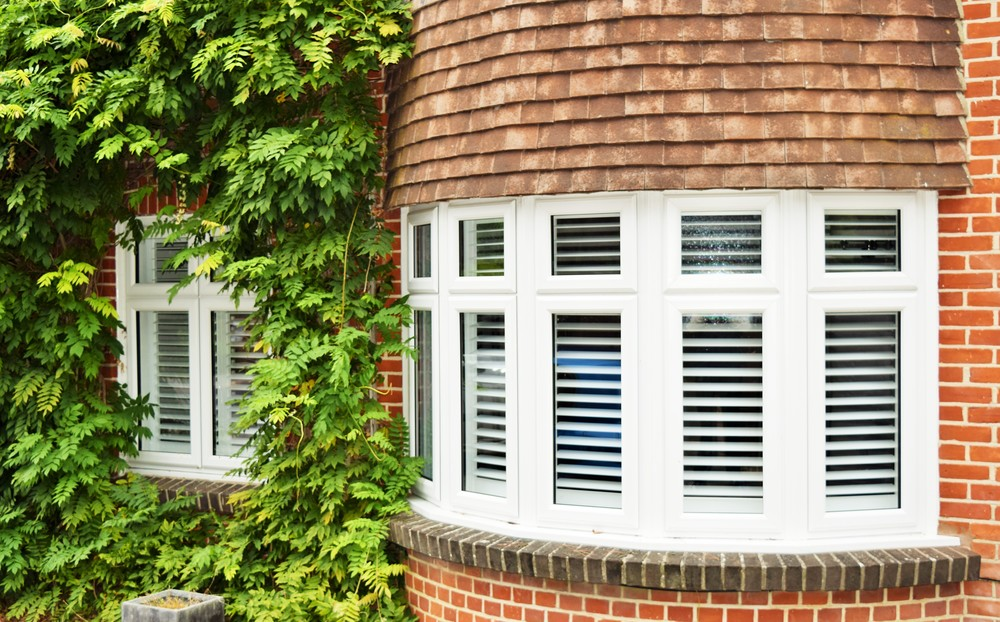 Exterior view of round bay window shutters