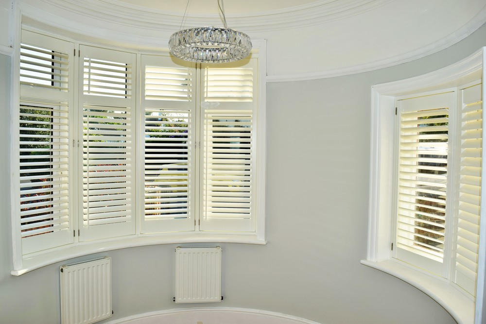 Rounded bay window plantation shutters