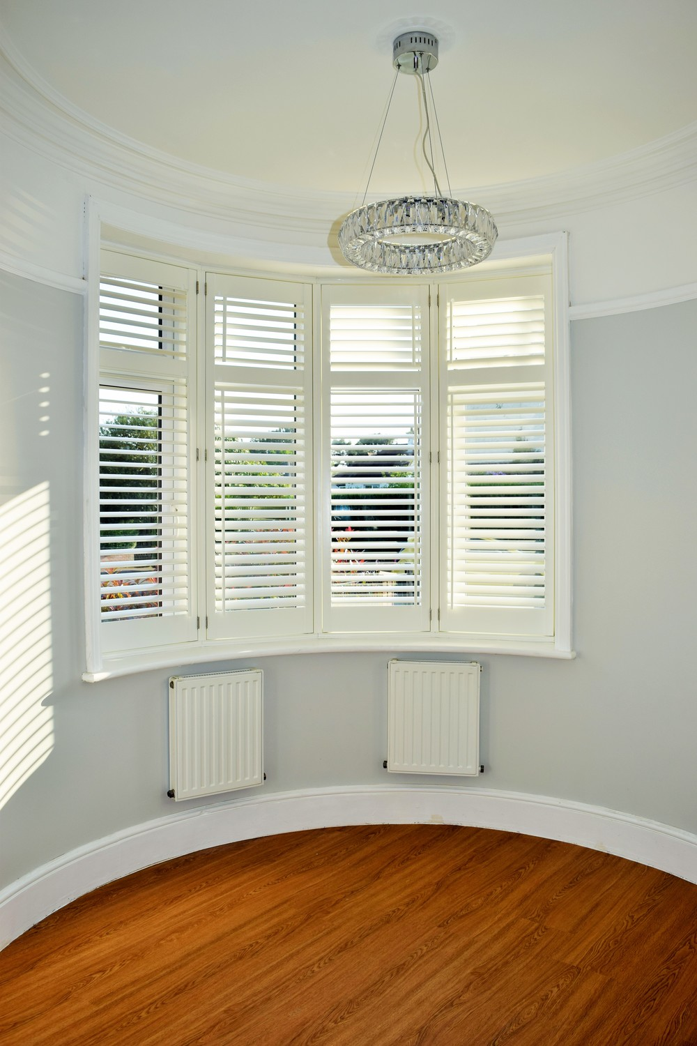 Round Bay window wooden shutters Poole