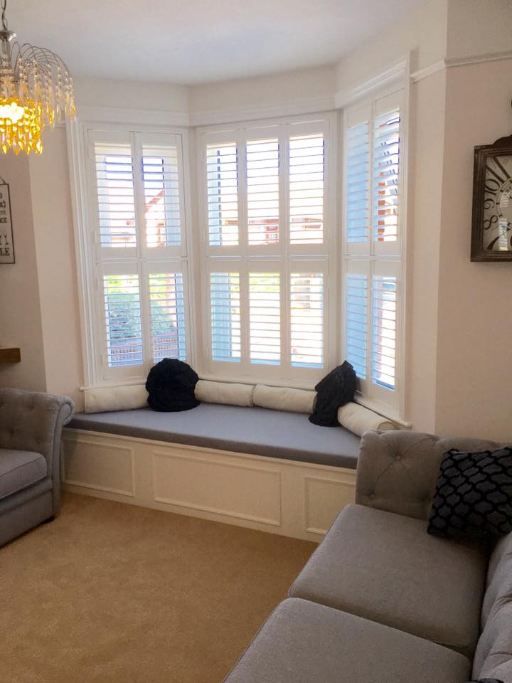 Tier on tier Bay window shutters Lymington