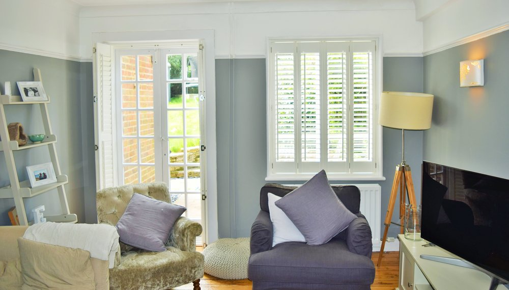 Patio door shutters and French door shutters on Georgian french door