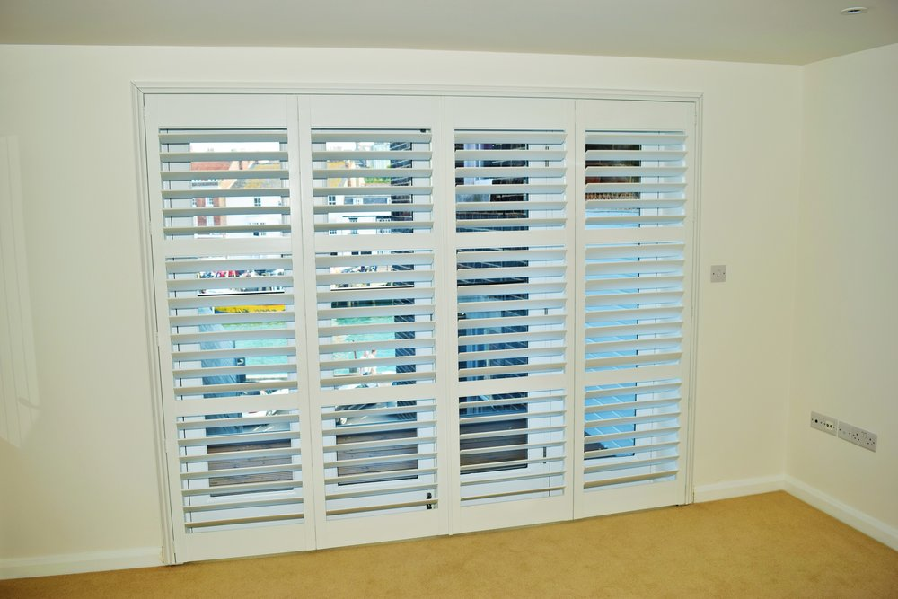 Wooden plantation shutters on large patio doors Weymouth Dorset