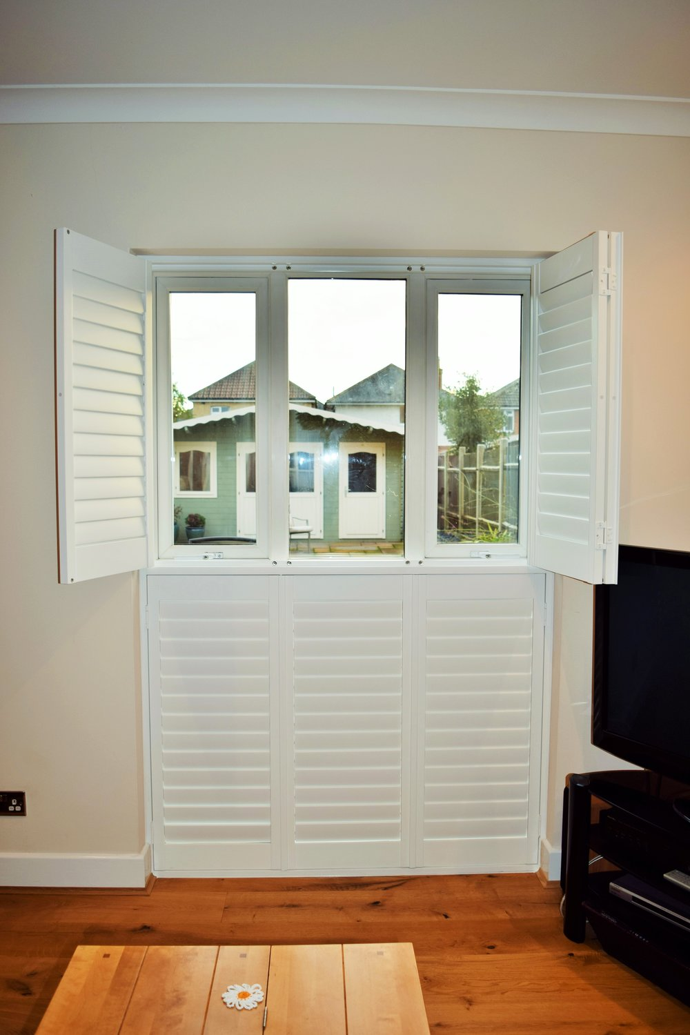 Tier on tier patio door shutters Bournemouth