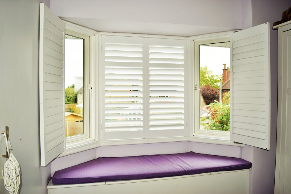 Bay window shutters with window seat