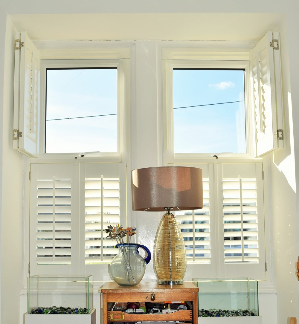 Plantation shutters tier on tier summer.JPG