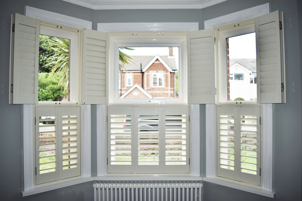 Tier on tier shutters with top tier open Bournemouth.JPG