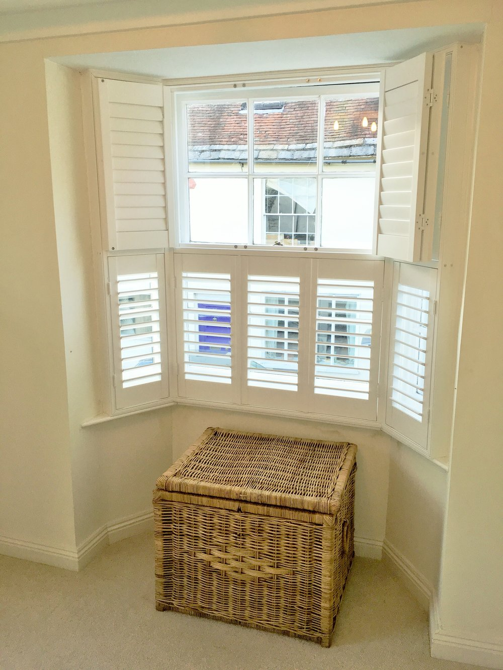 Bay window wooden shutters Blandford Forum.JPG