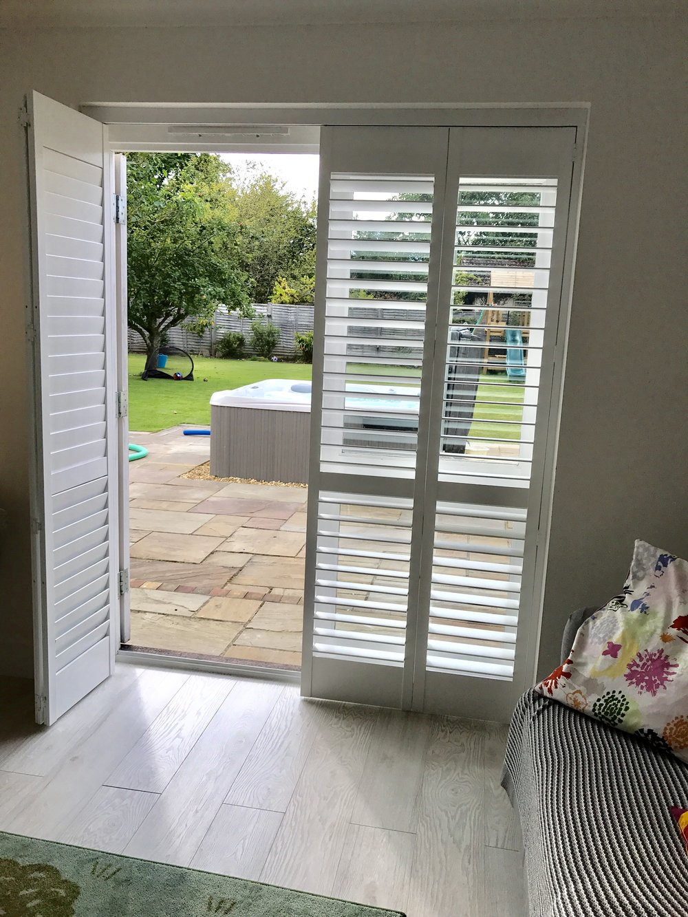 Patio door shutters on track