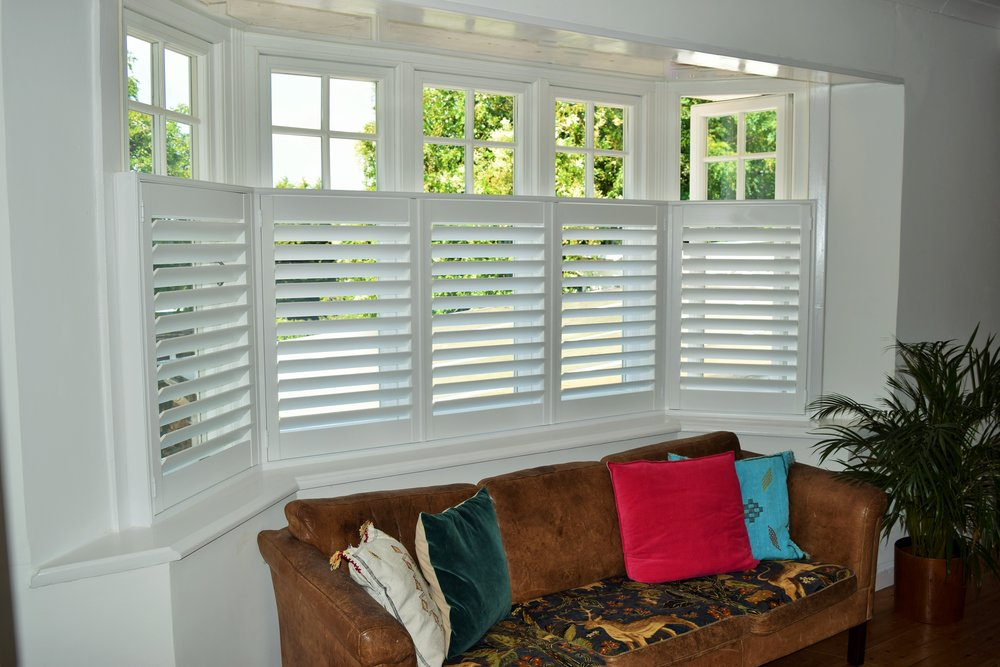 Cafe style Bay window plantation shutters Bournemouth.JPG