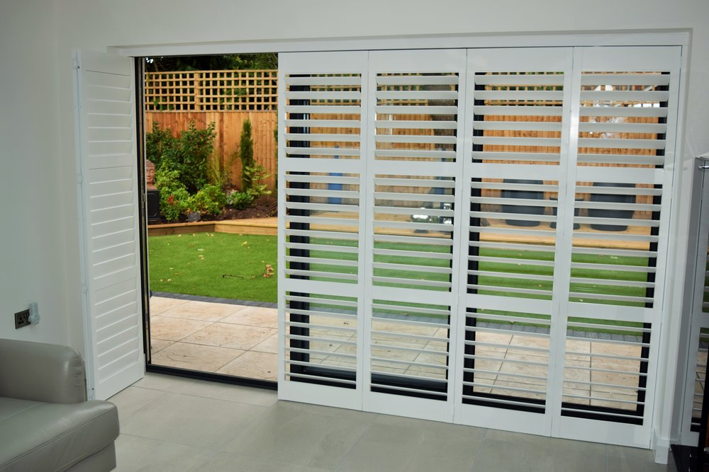 Tracked patio door shutters Verwood