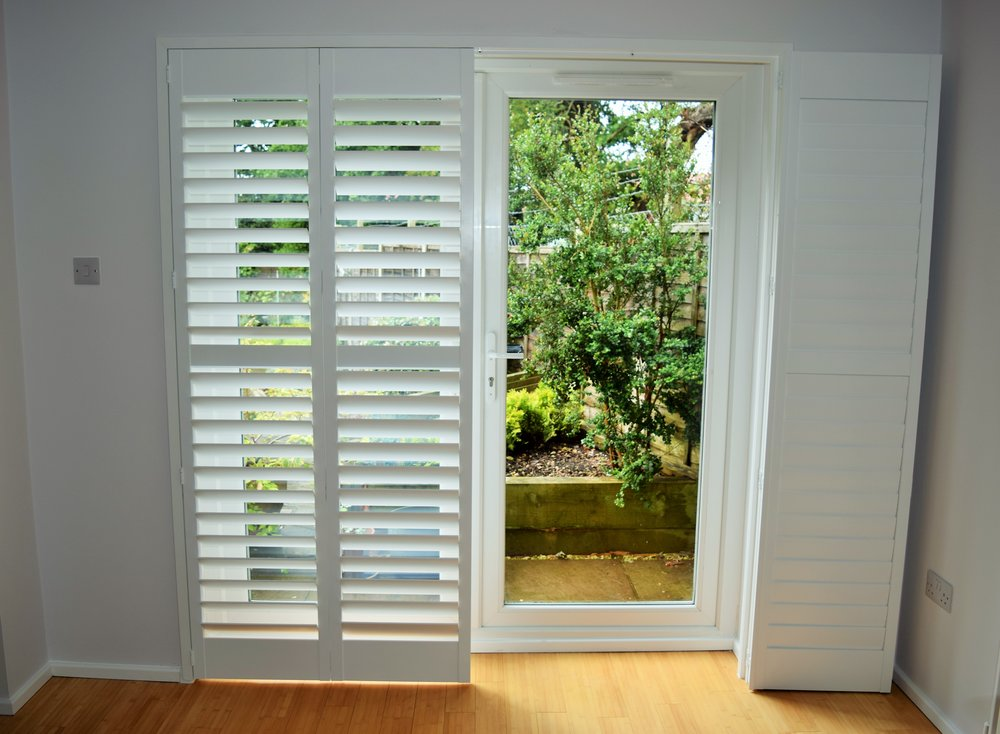 folding Patio door shutters on track.JPG