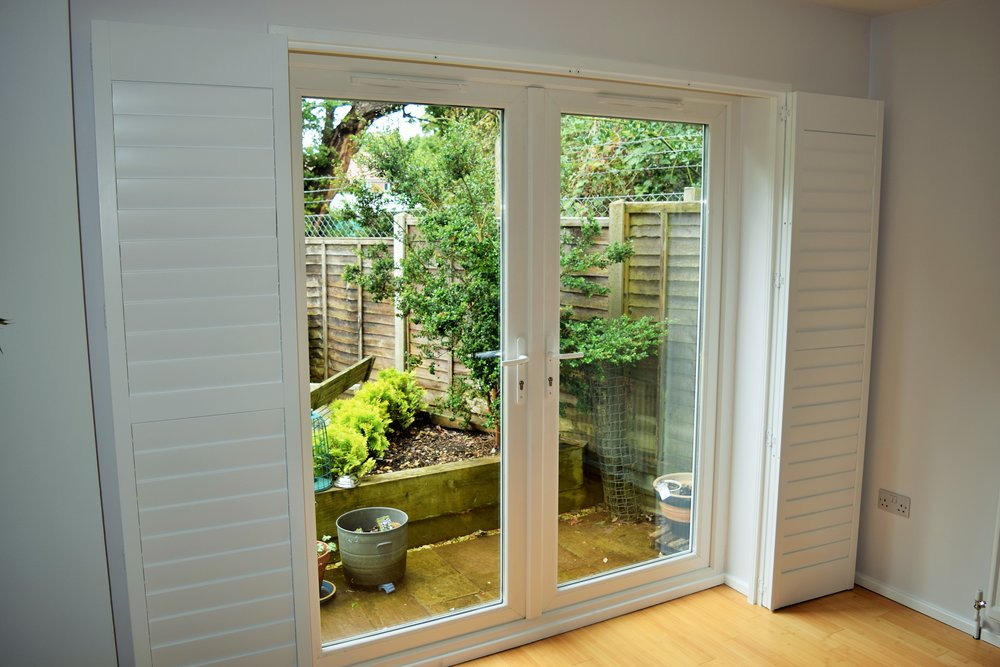 Patio door shutters on track.JPG