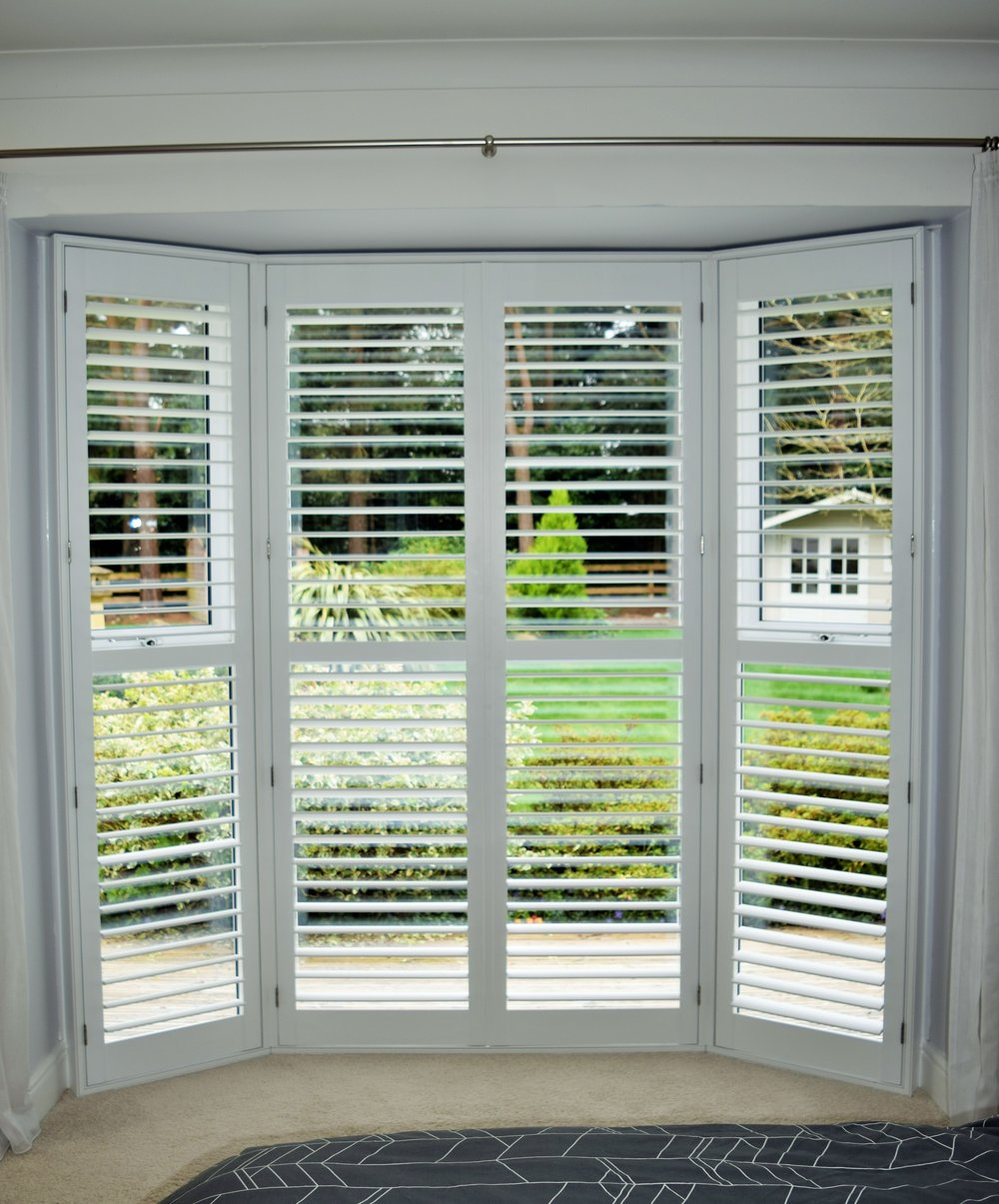 Patio door shutters close with open louvres Ringwood.JPG