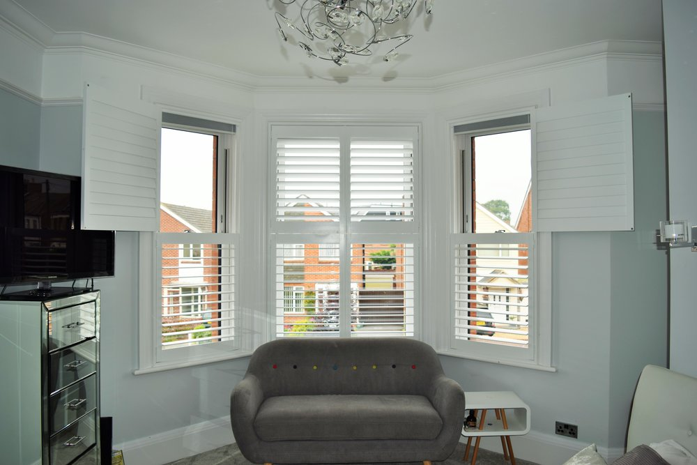 Tier on tier shutters on bay windo side panels open.JPG