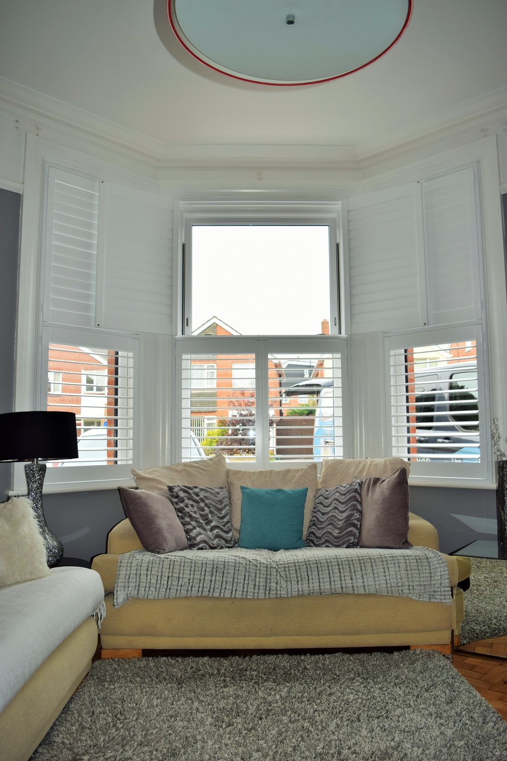 Tier on tier bay window shutters Bournemouth.JPG