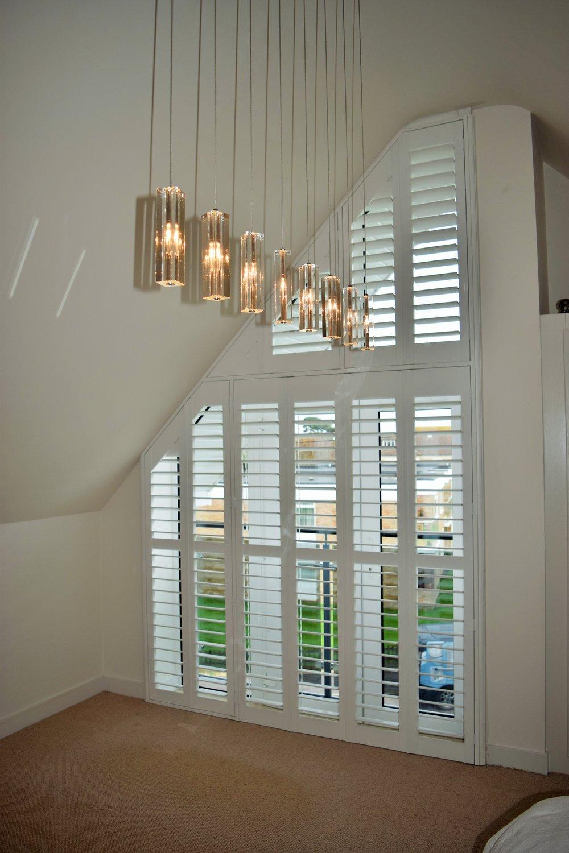 Triangular shape shutters with patio door