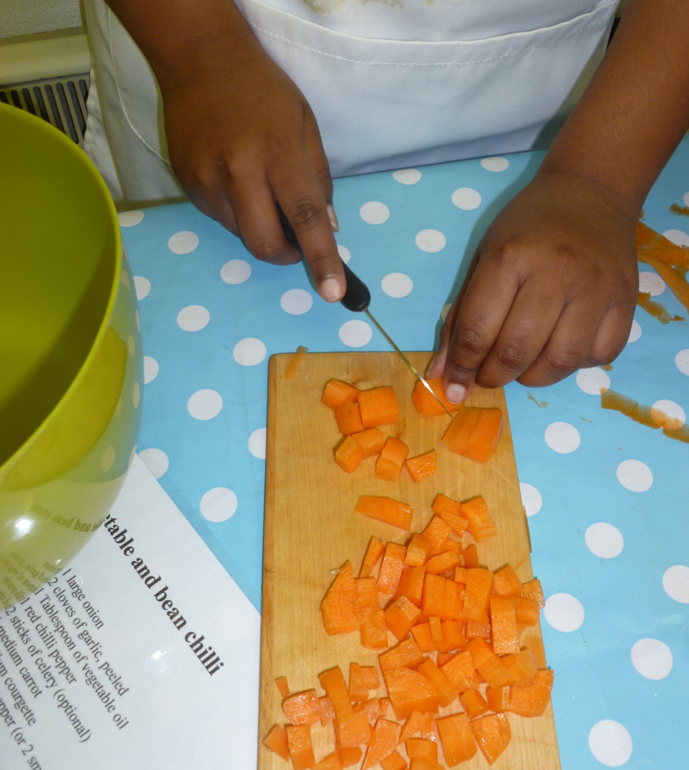 Chopping vegetables at St Michael on the Mount School for a vegetable and bean chilli