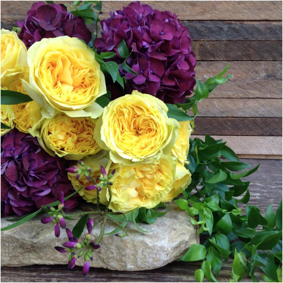 yellow garden roses and purple hydrangeas.jpg