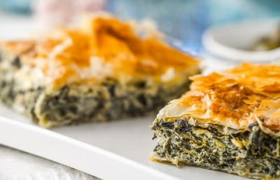 Spanakopitais a feta and spinach-filled pie made of filo pastry