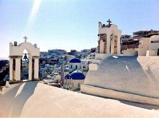 The famous blue dome churches in Oia Santorini