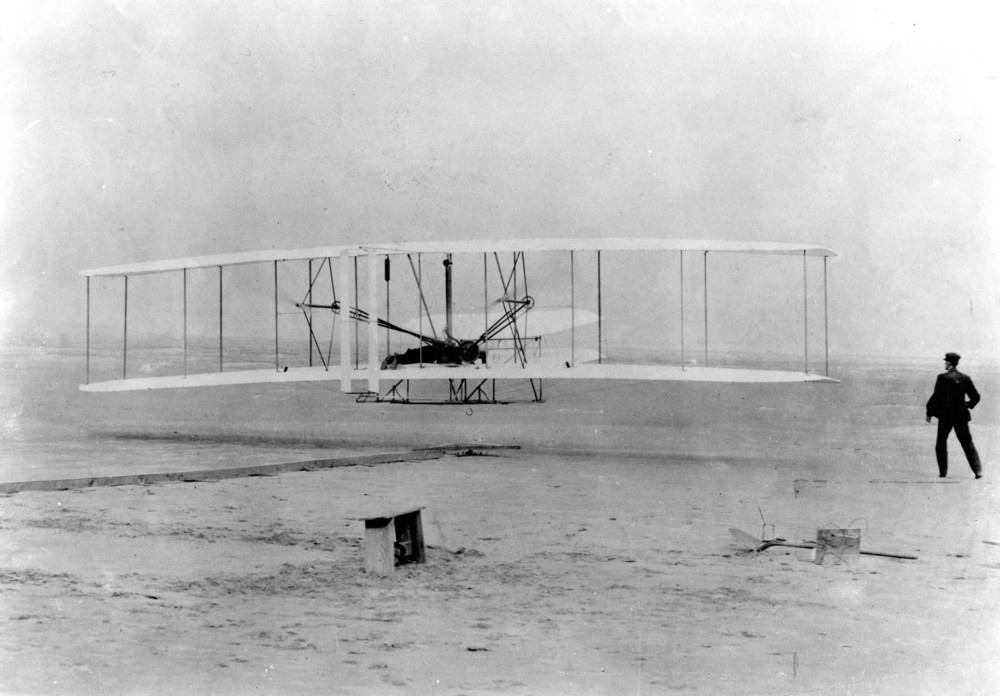 Orville and Wilbur Wright's first flight, Dec. 17, 1903, at Kittyhawk, N.C. (U.S. Air Force photo). First Flight. Image source: National Museum of the U.S. Air Force, public domain.