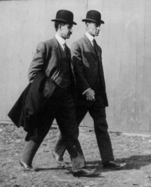 The Wright brothers at the International Aviation Tournament, Belmont Park, Long Island, N.Y., Oct. 1910. Image source: Wright Brothers in 1910.jpg, public domain.